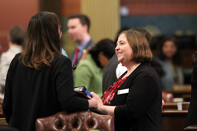 State Rep. Lori Stone (D-Warren) discusses legislation with members on the House floor on Tuesday, January 15, 2019.