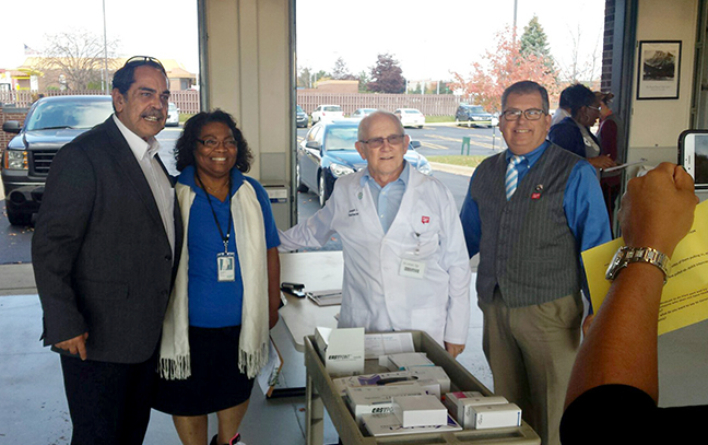 State Rep. Tim Sneller (D-Burton) assisted with the Free Drive-Thru Immunization Clinic put on by the Genesee Health Plan on October 13, 2017.
