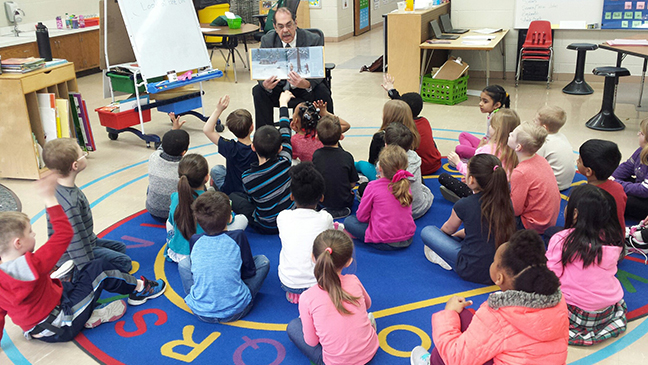 State Rep. Tim Sneller (D-Burton) reads to first grade students at Indian Hill Elementary School in Grand Blanc for March is Reading Month on Monday, March 12, 2018.