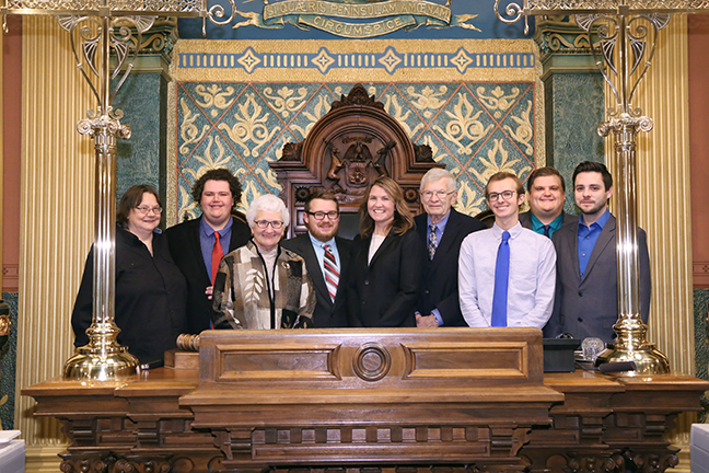 State Rep. Sara Cambensy (D-Marquette) with friends and family on the House floor in the state Capitol in Lansing on Thursday Nov. 16, 2017.