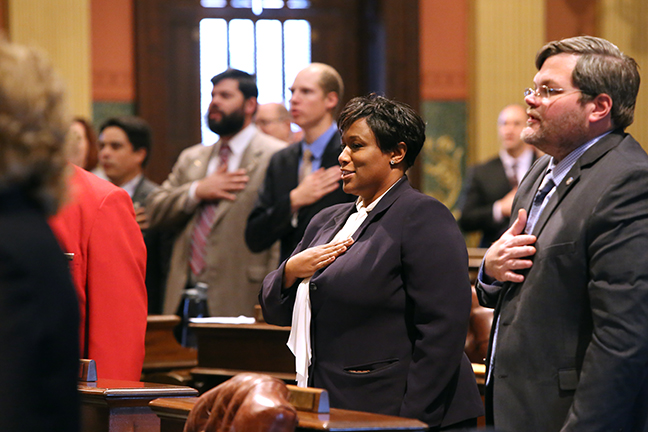 State Rep. Tenisha Yancey (D-Harper Woods) takes the Pledge of Allegiance on her first day of House session as a state representative, Tuesday, Nov. 28, 2017.