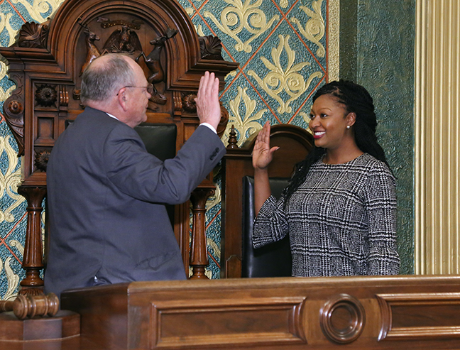 State Rep. Sarah Anthony (D-Lansing) is sworn in by House Clerk Gary Randall on Wednesday, November 14, 2018. Anthony was sworn in after winning the special election to finish out the term for former Rep. Andy Schor, who resigned to become mayor of Lansing. Anthony won both the special election to complete the term and the election for the 2019-20 term.