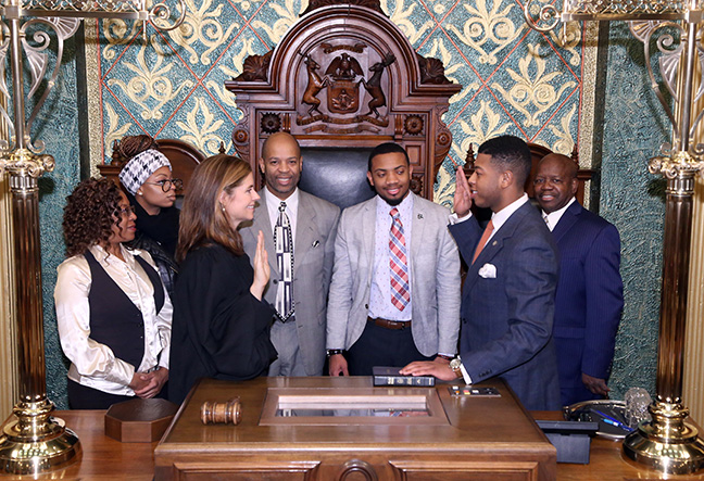 State Rep. Jewell Jones (D-Inkster) takes the oath of office from Michigan Supreme Court Justice Bridget Mary McCormack on Wednesday, Jan. 11, 2017, at the state Capitol in Lansing. With him are his father, Lyndon Jones, his mother, Octavia Smith, his sister Shaina Jones and his staff, Preston Peterson and Javion Johnson.