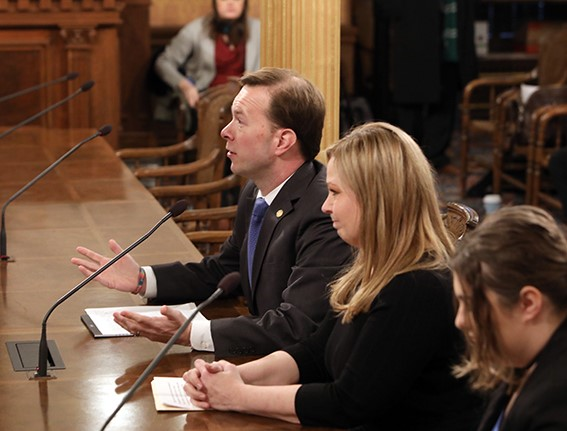 State Rep. Matt Koleszar (D-Plymouth),joined by Yvonne Sawyers-Swanson and Lily Sawyers, the widow and daughter of fallen Officer Mark Sawyers, testifies before the House Appropriation Committee on House Bill 4426 on Wednesday, December 11, 2019.