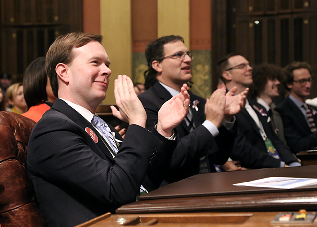 State Rep. Matt Koleszar (D-Plymouth) applauds Governor Gretchen Whitmer during her State of the State address Tuesday, February 12, 2019.