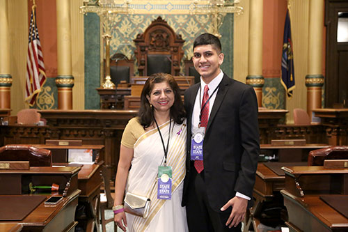 State Rep. Padma Kuppa (D-Troy) joined by her son Shreyas Tadapelli for Gov. Whitmer's first State of the State address in the Capitol in Lansing on Feb. 12, 2019.