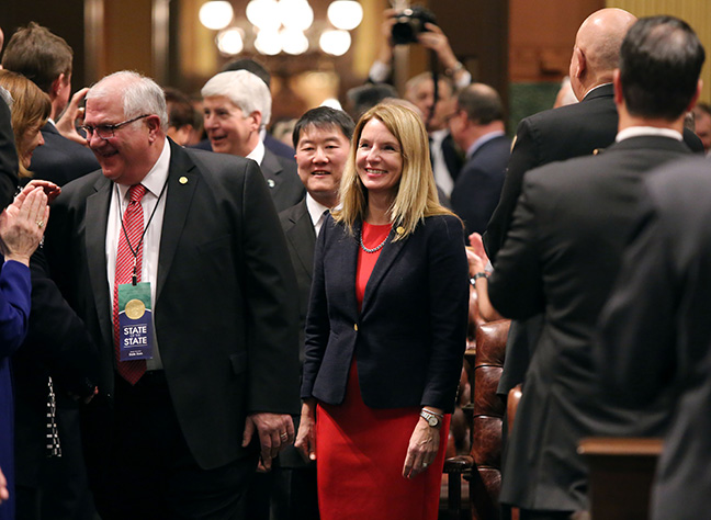 State Rep. Donna Lasinski (D-Scio Township) escorts Gov. Rick Snyder before the 2017 State of the State address at the State Capitol on Tuesday, Jan. 17, 2017. Rep. Lasinski attended the governor's address with her husband, Mike Lasinski.