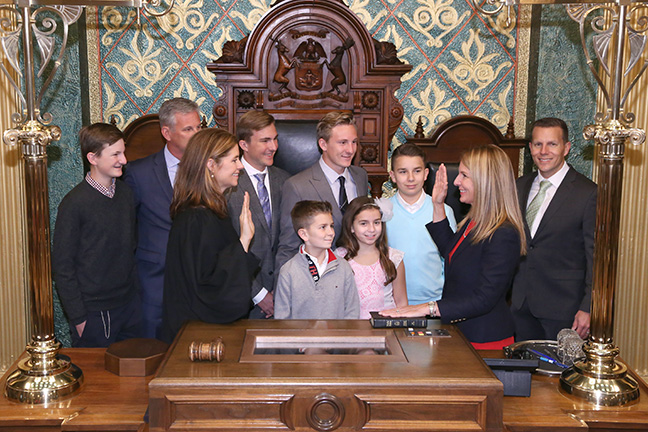 State Rep. Donna Lasinski (D-Scio Township) takes the oath of office from Michigan Supreme Court Justice Bridget Mary McCormack at the swearing-in ceremony for the official opening of the 99th Legislature of the Michigan House of Representatives on Jan. 11, 2017. Pictured with Rep. Lasinski is her husband Mike Lasinski, sons Alexander, Nathaniel and Jack Lasinski, brother Steven Kay, nephews Joshua and Matthew Kay, and niece Gianna Kay.