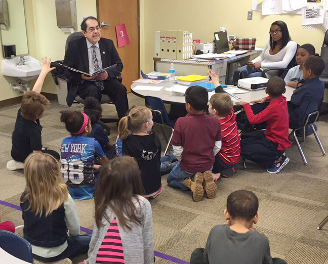 State Rep. Tim Sneller (D-Burton) read to students in celebration of March is Reading Month at Madison Academy on Friday, March 10, 2017