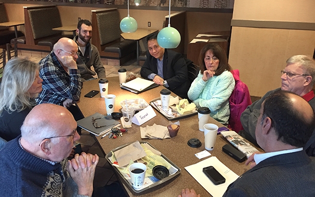 State Rep. Tim Sneller (D-Burton) welcomes residents to his community coffee hour at McDonald's in Grand Blanc on January 19, 2018.