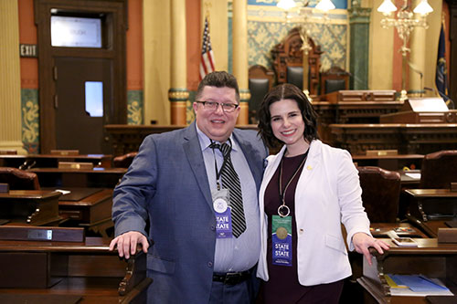 State Rep. Laurie Pohutsky (D-Livonia) was joined by Allen Freer, vice president of the UAW Local 600, for Gov. Whitmer's first State of the State address at the state Capitol in Lansing on Tuesday, Feb. 12, 2019.