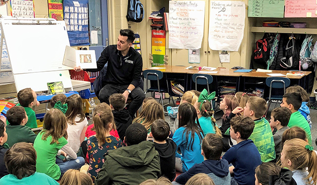 State Rep. Darrin Camilleri (D-Brownstown Township) reads to school children in celebration of March is Reading Month.