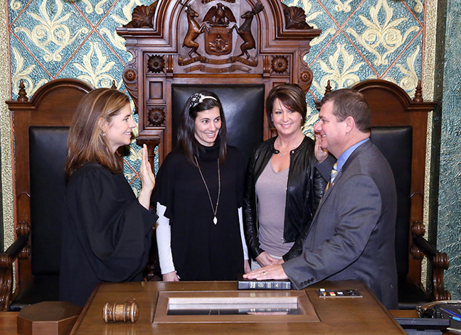 State Rep. Terry J. Sabo (D-Muskegon) takes the oath of office from Michigan Supreme Court Justice Bridget Mary McCormack on Wednesday, Jan. 11, 2017, at the state Capitol in Lansing. With him are his wife, Denise Sabo, and daughter Ryan Swanson.