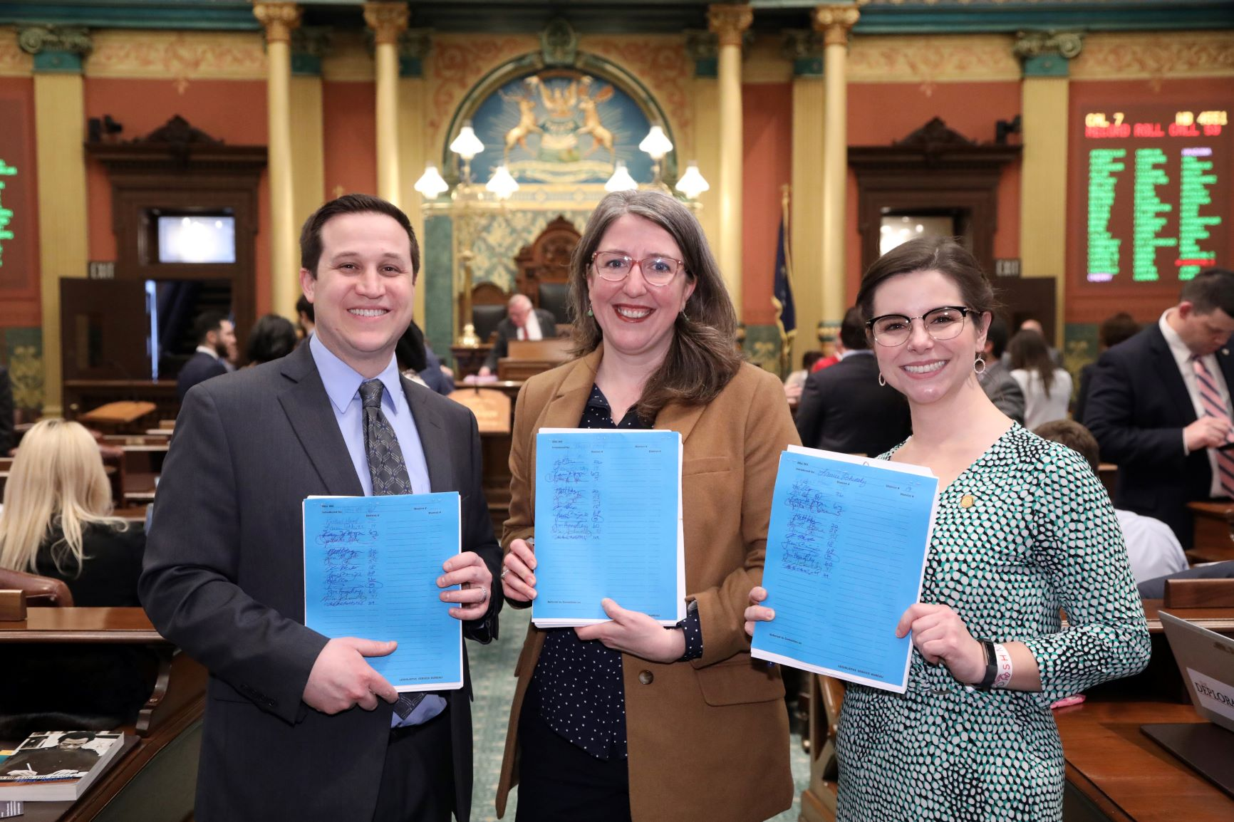 State Reps. Robert Wittenberg (D-Huntington Woods), Rachel Hood (D-Grand Rapids), Laurie Pohutsky (D-Livonia) introducing House Bills 5499-5501 to update Michigan's sexual education curriculum on the House floor in Lansing on Feb. 18, 2020