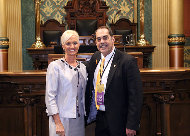State Rep. Tim Sneller (D-Burton) attends Gov. Rick Snyder's eighth State of the State address with special guest Dr. Lisa Hagel, superintendent of the Genesee Intermediate School District, on Tuesday, Jan. 23, 2018, at the state Capitol in Lansing.
