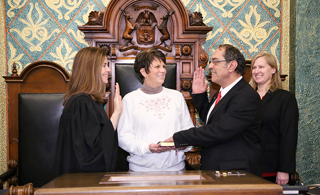 State Rep. Tim Sneller (D-Burton) was sworn in officially as representative for the 50th House District for the 2019-2020 legislative session, on Wednesday, January 9, 2019. The swearing-in ceremony marked the formal opening of Michigan's 100th Legislature.