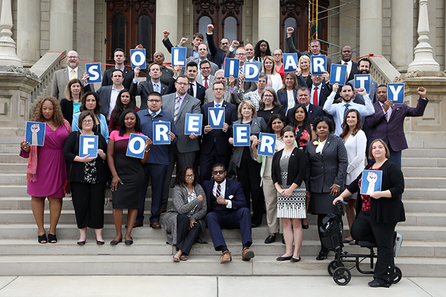 Democratic members of the House of Representatives show their support for the striking United Auto Workers members on Wednesday, September 18, 2019.