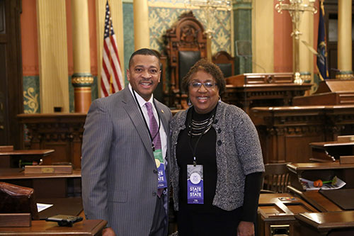 State Rep. Tyrone Carter (D-Detroit) joined by Western Wayne County NAACP President Gina Wilson-Steward for Gov. Whitmer's first State of the State address in the Capitol in Lansing on Tuesday, Feb. 12, 2019