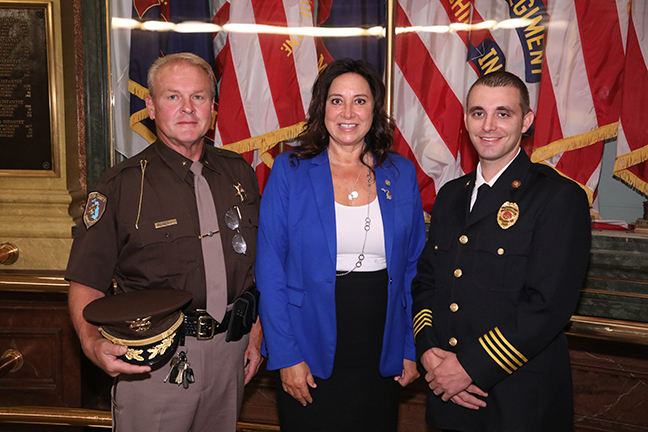 State Rep. Angela Witwer (D-Delta Township) welcomed Eaton County Sheriff Tom Reich and Charlotte Assistant Fire Chief Tyger Fullerton for the 9/11 commemoration ceremony at the Capitol Wednesday, September 11, 2019.