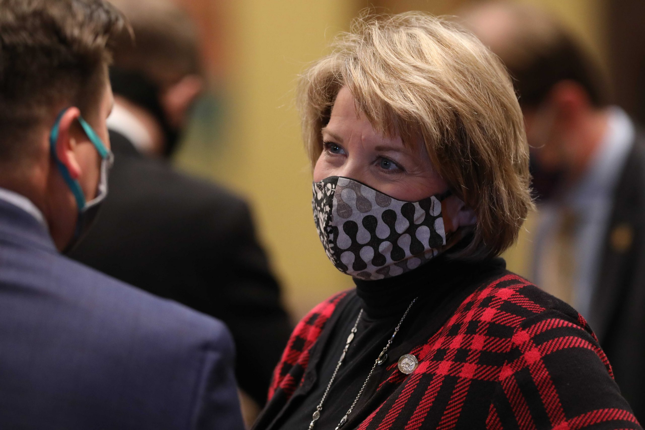 House Democratic Leader Christine Greig (D-Farmington Hills) speaking on the House floor protesting Republican refusal to require masks on the House floor at the Capitol in Lansing on Oct. 13, 2020.