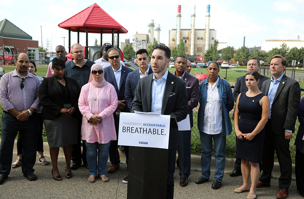 State Rep. Abdullah Hammoud (D-Dearborn) speaking at a House Democrats press conference announcing legislation to fight corporate pollution and stand up for clean air in front of the AK Steel Plant in Dearborn on Aug. 21, 2019.