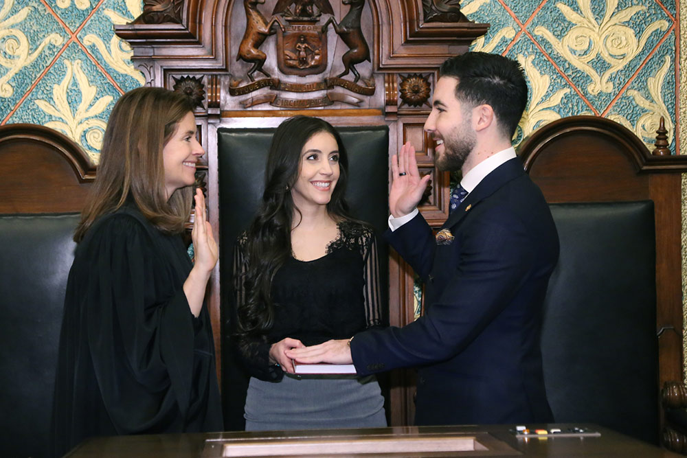 State Rep. Abdullah Hammoud (D-Dearborn) and his wife, Fatima, as he is sworn in as representative for the 2019-2020 legislative term by Chief Justice Bridget Mary McCormack of the Michigan Supreme Court.