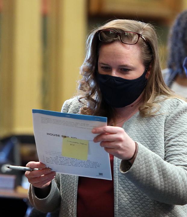 State Representative Kelly Breen (D-Novi) studies potential legislation on the House floor February 10, 2021.