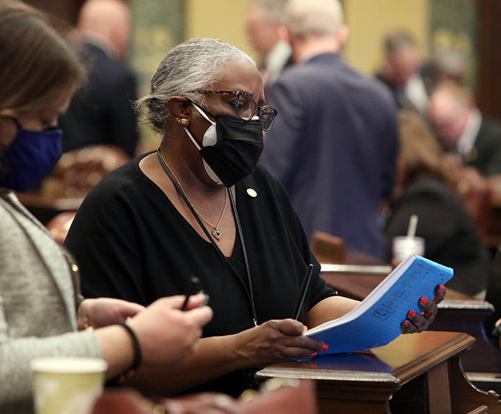 State Rep. Helena Scott (D-Detroit) studies a bill on the House floor on February 23, 2021.