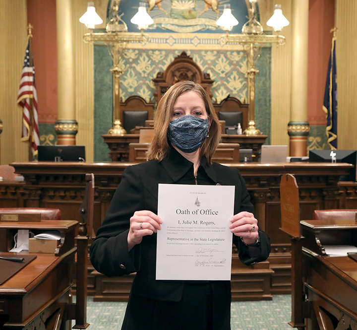 Newly-elected state Representative Julie M. Rogers (D-Kalamazoo) with her Oath of Office after being sworn in on December 3, 2020.