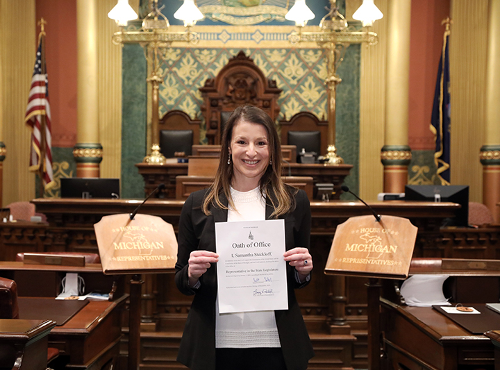Newly-elected state Representative Samantha Steckloff (D-Farmington Hills) shows off her Oath of Office after being sworn in on December 11, 2020.