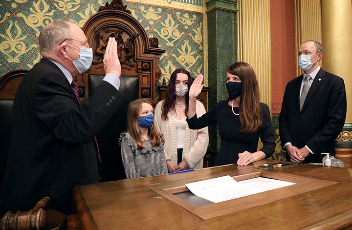 House Clerk Gary Randall swore in newly-elected state Representative Christine Morse (D-Portage) on December 11, 2020.