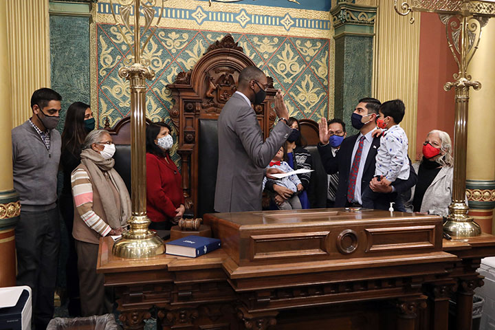 Lieutenant Governor Garlin Gilchrist swore in newly-elected State Representative Ranjeev Puri (D-Canton) with his family in attendance on the House floor on December 16, 2020.