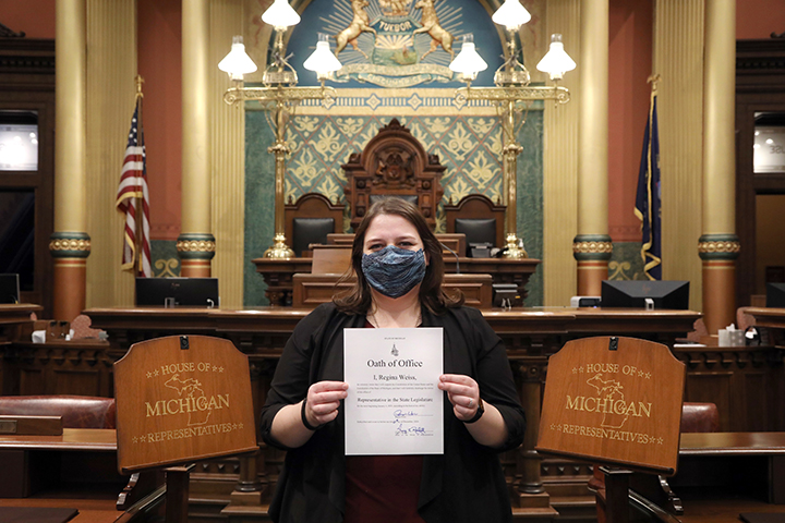 Newly-elected state Representative Regina Weiss (D-Oak Park) shows off her Oath of Office after being sworn in on December 21, 2020.