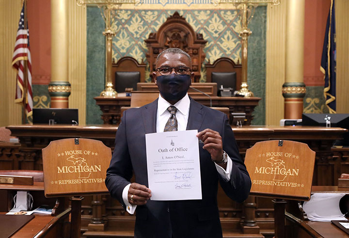 Newly-elected state Representative Amos O'Neal (D-Saginaw) with his Oath of Office after being sworn in on December 11, 2020.