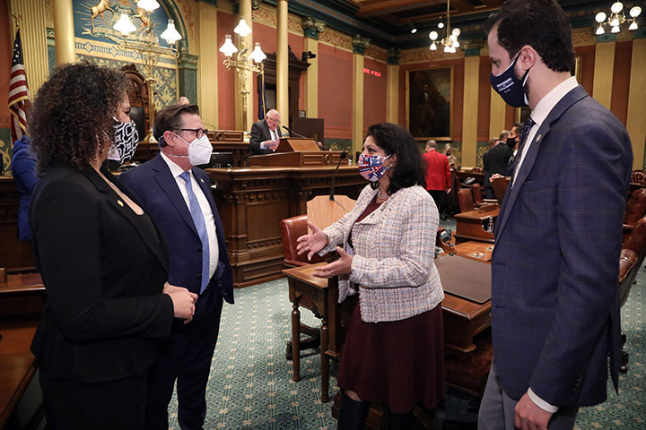 State Rep. Padma Kuppa (D-Troy) talked with other representatives during the first day of the 2021-22 legislative session on January 13, 2021.