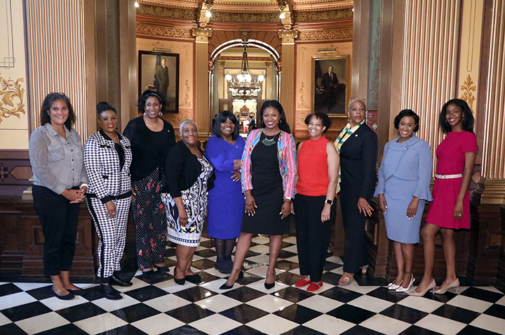 The Black women legislators of the 101st Michigan House of Representatives. From left to right: State Representatives Felicia Brabec (D-Pittsfield Twp.), Cynthia Neeley (D-Flint), Stephanie Young (D-Detroit), Helena Scott (D-Detroit), Brenda Carter (D-Pontiac) Sarah Anthony (D-Lansing), Karen Whitsett (D-Detroit), Cynthia A. Johnson (D-Detroit), Tenisha Yancey (D-Harper Woods) and Kyra Bolden (D-Southfield).