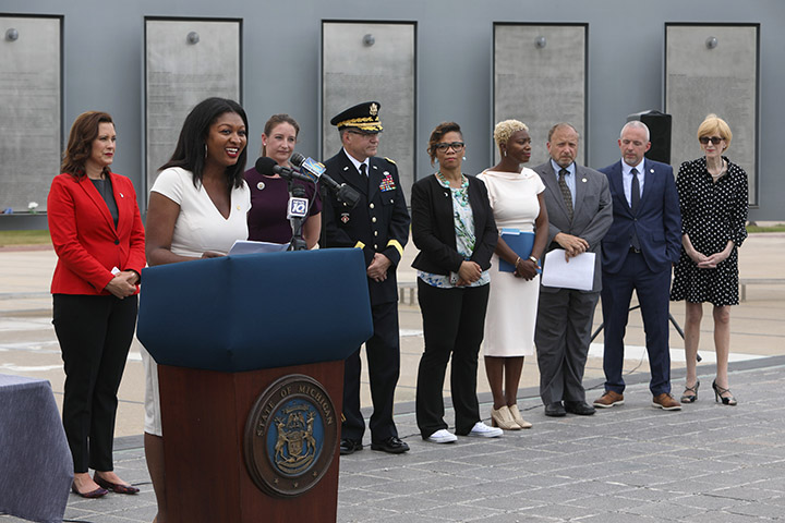 State Rep. Sarah Anthony (D-Lansing) joined Gov. Whitmer and other stakeholders for the signing of a package of bills that will remove barriers to help veterans and their families continue their careers in Michigan, on June 9, 2021.