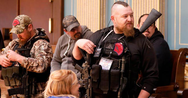 Michigan's Capitol served as a dress rehearsal for the attempted insurrection whenarmed protesters entered the building on April 30, 2020, Lasinski writes. Jeff Kowalsky, AFP Via Getty Images