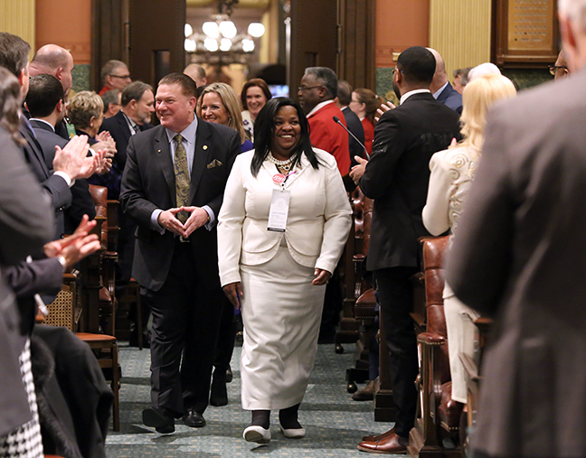 State Rep. Brenda Carter (D-Pontiac) escorted the state officers into the House chambers for the State of the State address Tuesday, February 12, 2019