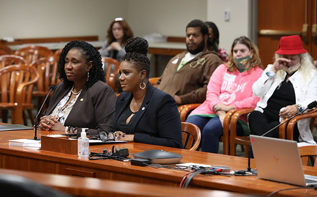 """State Reps. Cynthia Neeley (D-Flint) and Stephanie Young (D-Detroit) testified on bills that would increase penalties for drive-by shootings in the House Committee on the Judiciary on October 5, 2021. Members of a Flint family tearfully watched the testimony in favor of """"Messiah's Law,"""" the four-bill package arising out of the drive-by murder of their 3-year-old family member."""